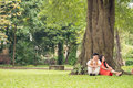 Pastime together copy spaced image of a senior couple in love resting in the park Royalty Free Stock Images