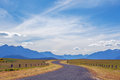 Pastoral winding country road and mountains in Fiordland, New Ze Royalty Free Stock Photo