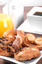 Pastries with cup of tea and orange juice selective focus Royalty Free Stock Photography