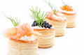 Pastries with salmon caviar shrimp and dill Royalty Free Stock Photos