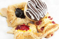 Pastries shot on wax paper on a white background Royalty Free Stock Images