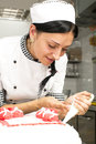 Pastry cake decorating chef decorates a in a candy store Royalty Free Stock Photo