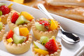 Pastry cakes with fruit tartlets inside the white tray Stock Photo