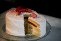 The pastry chef cut the cake. Strawberry yogurt cake. Consists of butter sponge cakes,covered with cream-based live Royalty Free Stock Photo