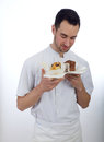 Pastry chef looking at his homemade pastries chocolate muffins Royalty Free Stock Photography