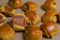 Pastry with cinnamon filling small shiny rolls Stock Photos