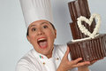 Pastry cook woman holding chocolate cake happy a big design Royalty Free Stock Photography