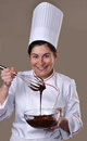 Pastry cook woman tasting chocolate funny cream Royalty Free Stock Photography
