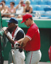 Pat burrell and negro leagues legend buck o neill philadelphia phillies of behind the batting cage with image taken from color Royalty Free Stock Photography