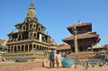 Patan, Nepal, October, 26, 2012, Nepali  Scene: Tourists walking on ancient Durbar square.  In may 2015 square partially destroyed Royalty Free Stock Photo