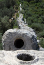 Patara aqueduct big stones of in turkey Stock Photography