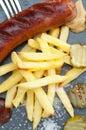 Patatas fritas con la salchicha Fotografía de archivo