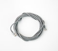 Patch cord network cable with molded RJ45 plug, isolated on a white background Royalty Free Stock Photo
