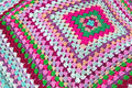Patchwork knitted blanket photo of a colourful crocheted ideal for background Royalty Free Stock Image