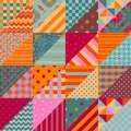 Patchwork seamless pattern. Colorful ornamental triangle patches combine in squares Royalty Free Stock Photo