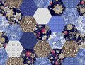 Patchwork seamless pattern from hexagonal patches with flowers, polka dot and denim print. Quilt design in blue and brown colors Royalty Free Stock Photo