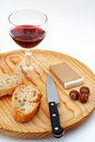Pate, bread, glass of red wine, hazelnuts and knife on wood plat Stock Photo