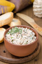 Pate of smoked fish with sour cream and greens on a wooden board vertical Royalty Free Stock Image