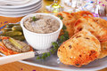 Pate with toast homemade chicken liver toasted sourdough and gherkins arranged on a platter Royalty Free Stock Image