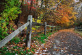 Path in autumn colorful trees over a walking and fence during at sharon woods southwestern ohio usa Royalty Free Stock Photo