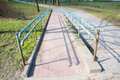 Path with barrier leading to a park Stock Image