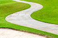 Path curving through green grass in golf course. Royalty Free Stock Photo