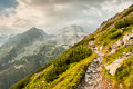 Path in mountains mountain landscape with a at summer sunset Royalty Free Stock Image