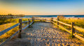 Path over sand dunes to the Atlantic Ocean at sunrise in Ventnor Royalty Free Stock Photo