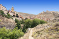 Path to albarracin located in the spanish province of teruel see the mountain with rocks and trees surrounded the village it s a Stock Photos