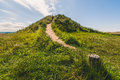 Path up grassy mound Royalty Free Stock Photo