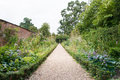 Pathway through a Formal garden flower bed Royalty Free Stock Photo