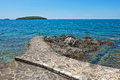 Pathway on the rocky beach in Istria Royalty Free Stock Photo