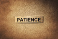 Patience word with scratches paper Royalty Free Stock Photo