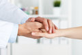 Patient cheering and support friendly male doctor s hands holding female s hand for encouragement empathy partnership trust Stock Photography