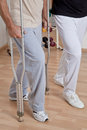 Patient on crutches and physician discusses his progress Royalty Free Stock Photo