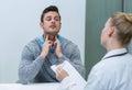 Patient discussing his problem with female patient
