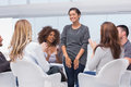 Patient has a breakthrough in group therapy and everyone is clapping her Royalty Free Stock Photo