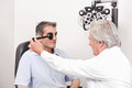 Patient having his eyesight tested man taking an test examination Royalty Free Stock Photos