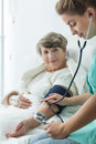 Patient with hypertension image of female elderly Stock Photography