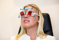 Patient at optometrist with trial frame for test glasses customer a optician trying in a eyeglasses Royalty Free Stock Photography