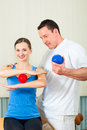Patient at the physiotherapy doing physical therapy female exercises with her therapist they using a massage ball Stock Image