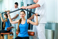 Patient at the physiotherapy doing physical therapy making exercises with her therapist Royalty Free Stock Photo