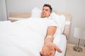 Patient resting on bed with iv drip Royalty Free Stock Photo