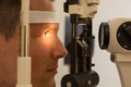 Patient at slit lamp of optician or optometrist customer Stock Image