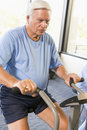 Patient Working Out On Exercise Machine Royalty Free Stock Photos