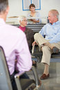 Patients In Doctor's Waiting Room Royalty Free Stock Photos