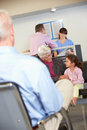 Patients In Doctor's Waiting Room Stock Photos