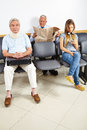 Patients waiting in waiting room three a of a hospital Royalty Free Stock Images