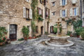 Patio with fountain in the old village Tourrettes-sur-Loup Royalty Free Stock Photo