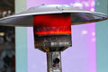 Patio heater outdoor gas lamp burning red Stock Photo